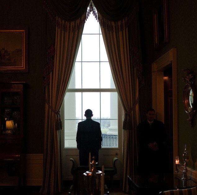 WASHINGTON - MARCH 26: In this handout provide by the White House, U.S. President Barack Obama looks out the Green Room window prior to the