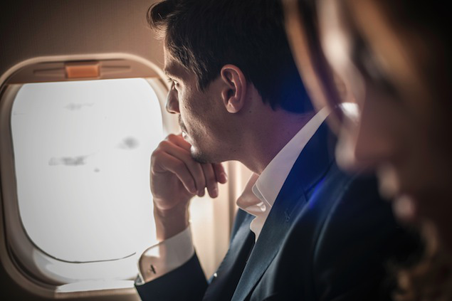 Minimum usage fee is GBP 35 Mandatory Credit: Photo by Cultura/REX (2982331a) Model Released - Male passenger looking out of aeroplane window VARIOUS