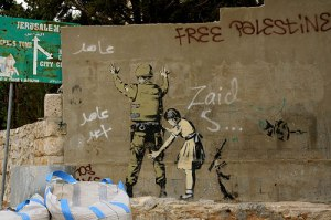 'The Girl frisking a Soldier', by Banksy